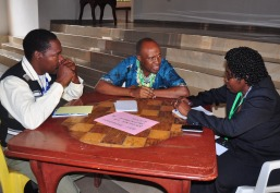 Hassan Lugendo (middle) and other representatives of the Babati District Management discussing issues of concern that they will tackle through the platform